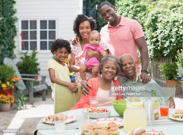 Multi-generation family enjoying barbecue