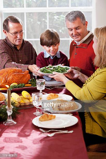 Multi-generation family enjoying holiday dinner