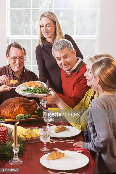 Multi-generation family enjoying holiday turkey dinner