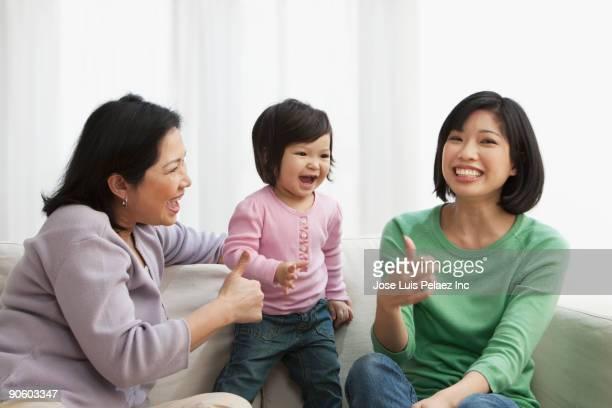 Multi-generation family on sofa
