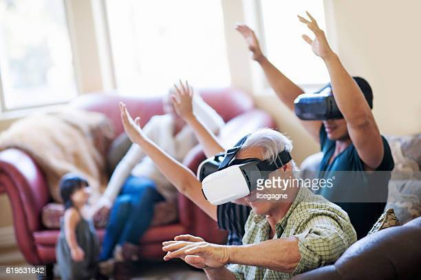 Multigeneration Family playing with VR