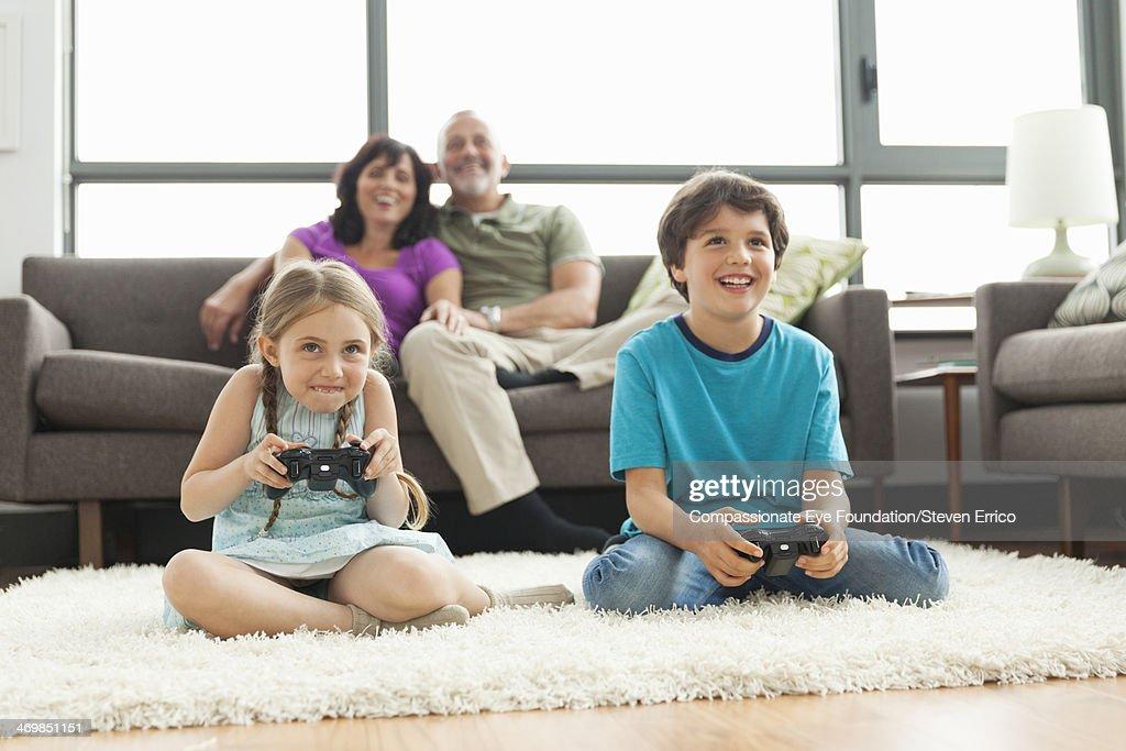 Multi-generation family relaxing in living room
