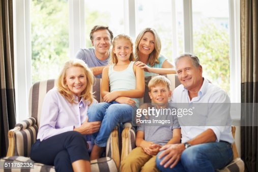 Multi-generation family smiling at home