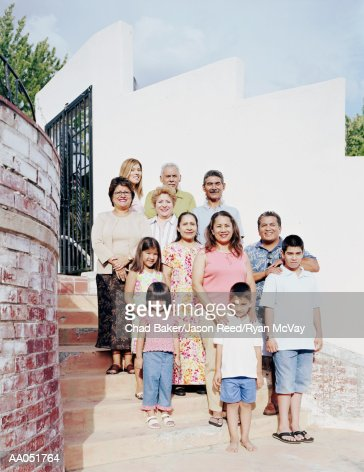 Multi-generation family standing on stairway, portrait : Stock Photo