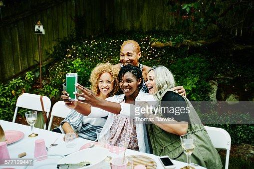 Multi-generation family taking self portrait