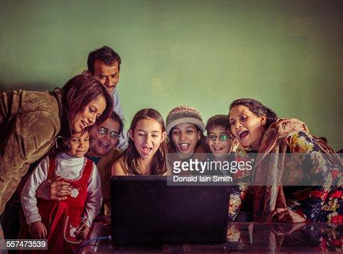 Multi-generation family videochatting on laptop