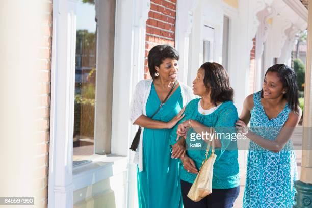 Multi-generation family walking and talking
