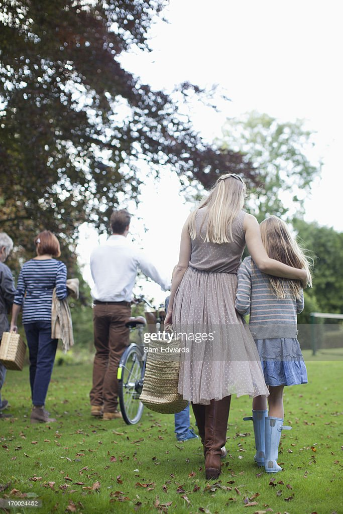 Multi-generation family walking in park : Stock Photo