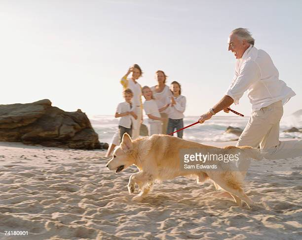 Multigenerational family at beach with dog