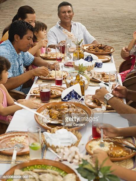 Multigenerational family dining outdoors