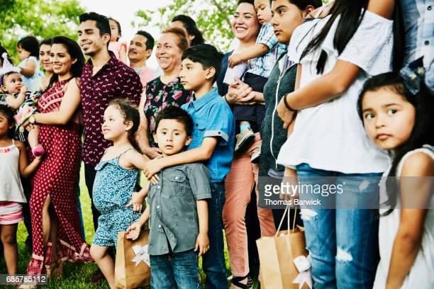Multigenerational family having birthday party gathered for family portrait