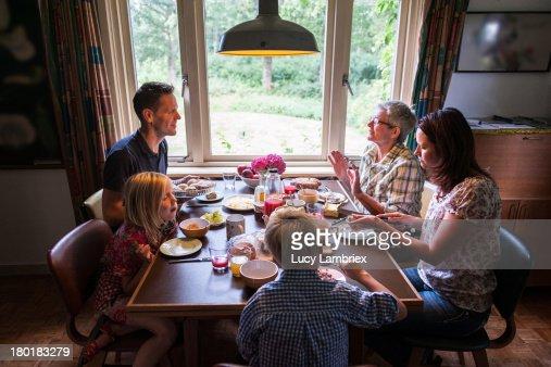Multi-generational family having breakfast