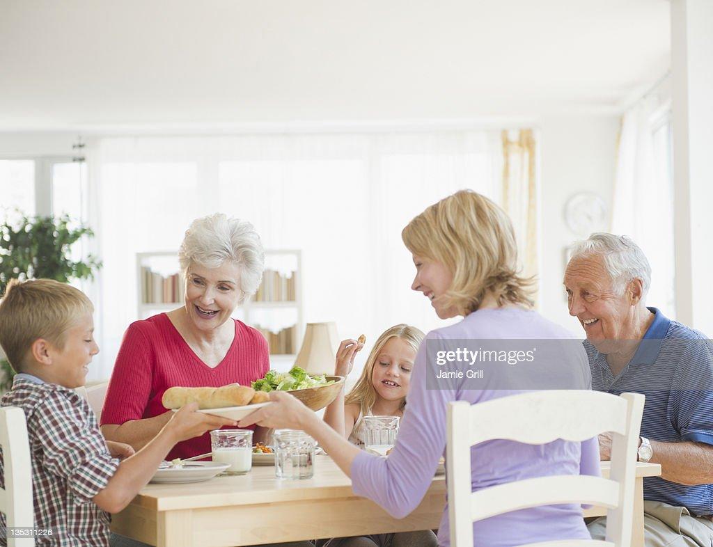 Multi-generational family having dinner together : Stock Photo
