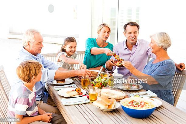 Multi-Generational Family Having Meal Together Al Fresco