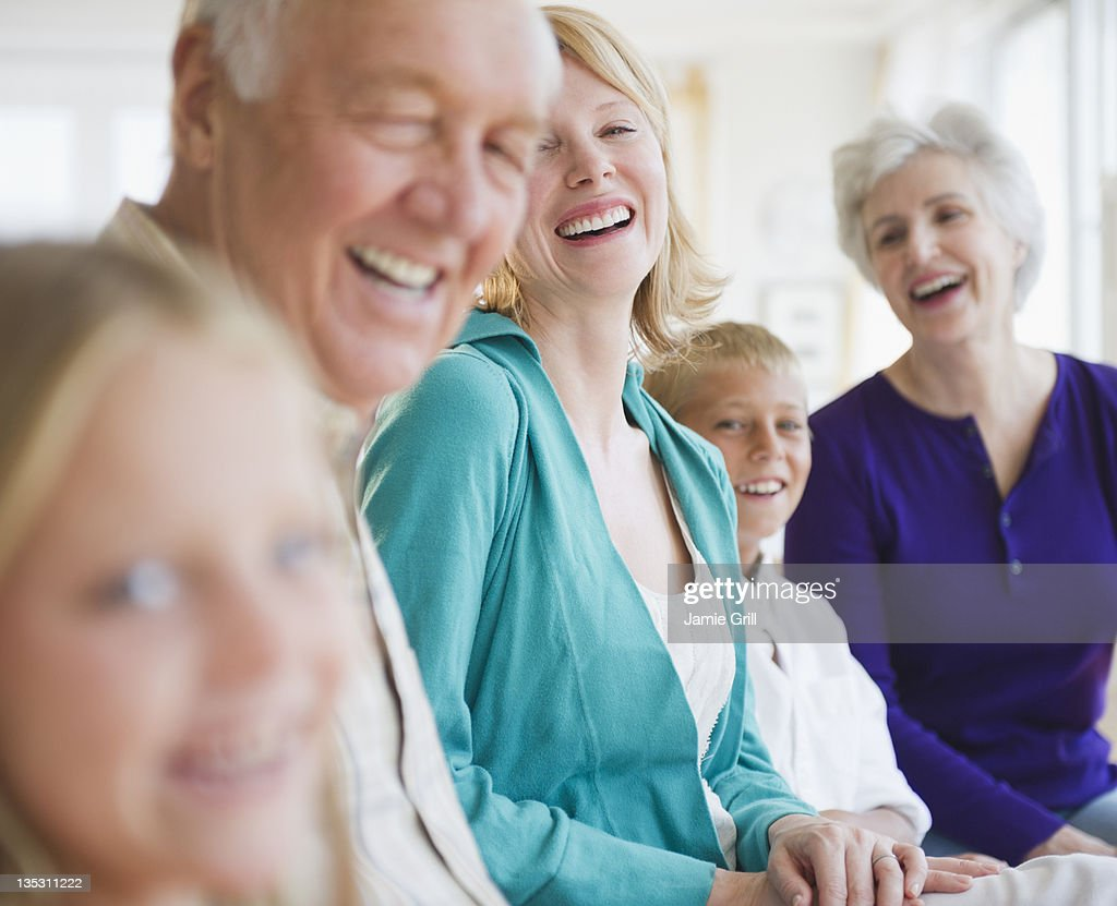 Multi-generational family laughing together : Stock Photo