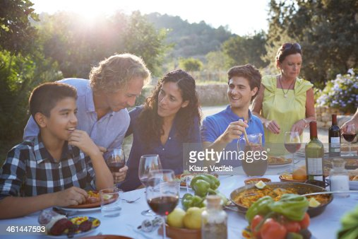Multigenerational family laughing together