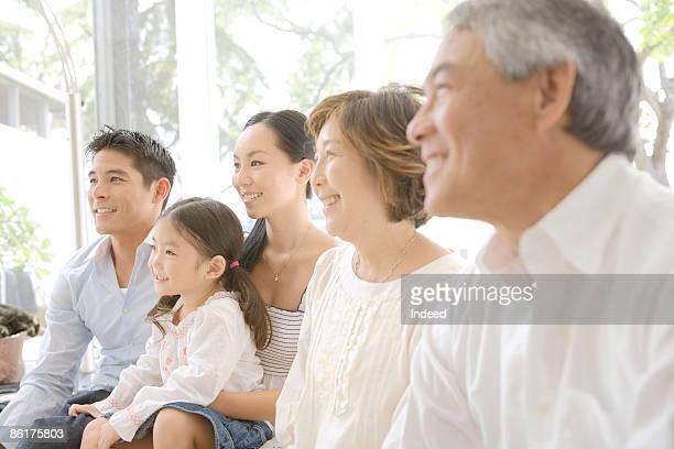Multigenerational family looking away