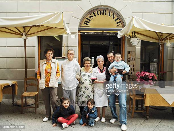 Multi-generational family outside restaurant, portrait