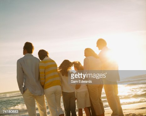 Multigenerational family portrait outdoors at sunset : Stock Photo