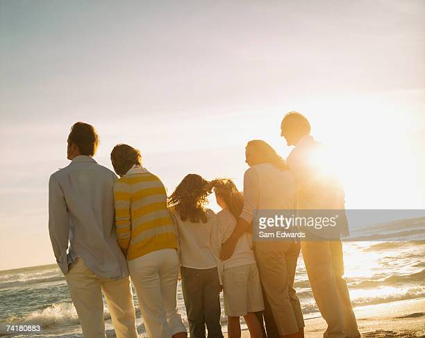 Multigenerational family portrait outdoors at sunset