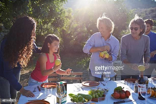 Multigenerational family preparing dining table