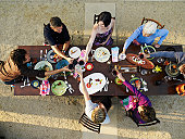 Multigenerational family toasting at outdoor table