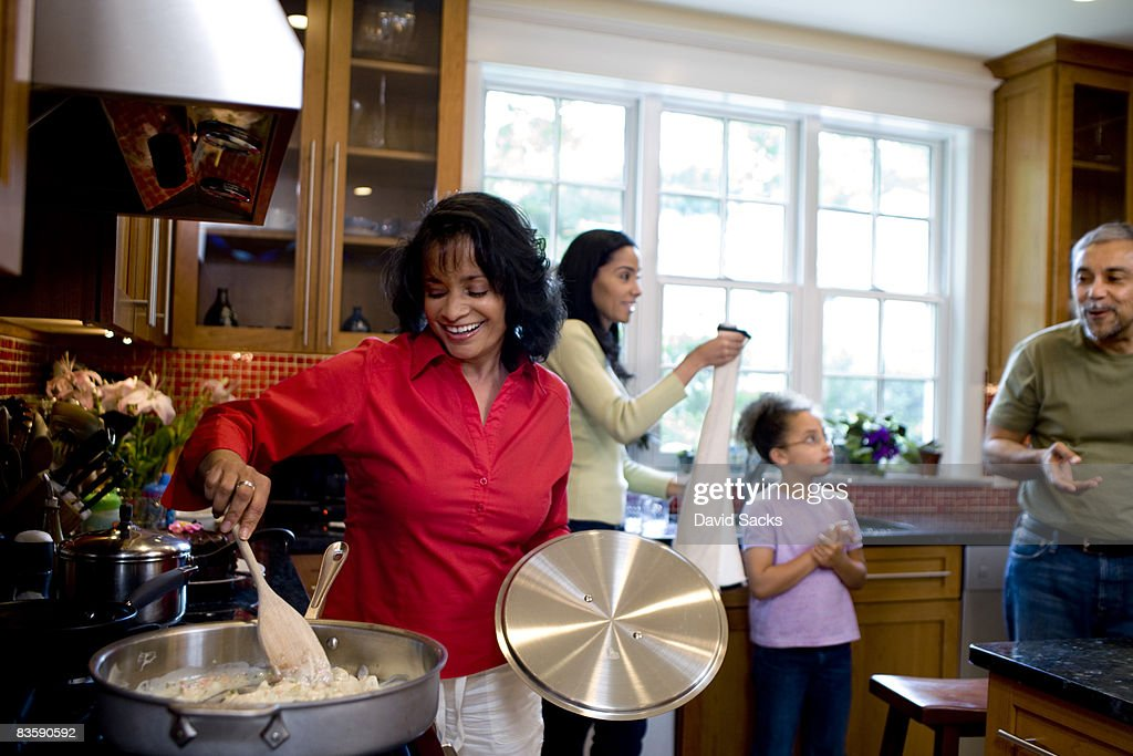 Multigenerational family together in kitchen : Stock Photo