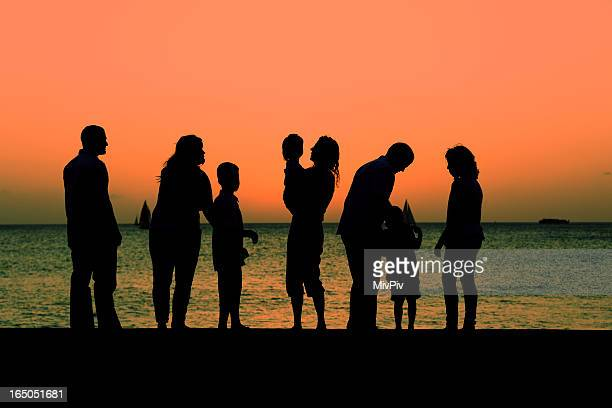 Multigenerational family watching the sunset