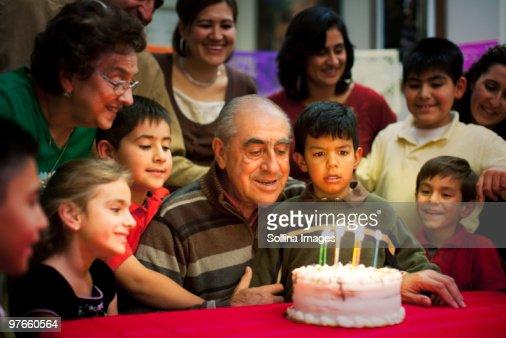 Multigenerational Hispanic Birthday Celebration Stock