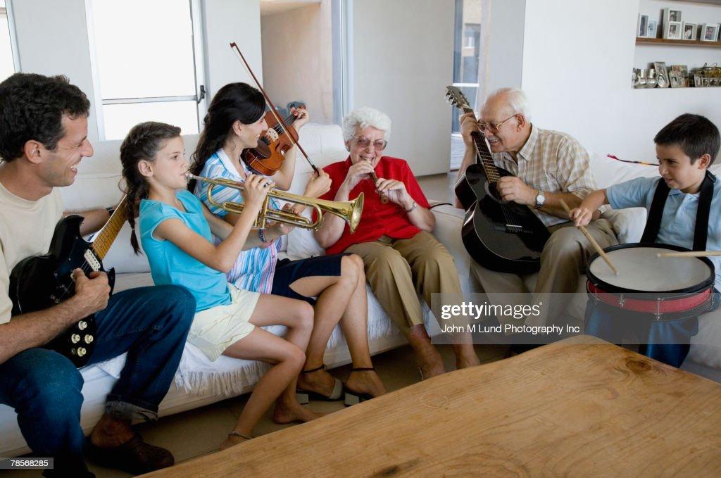 Multi-generational Hispanic family playing musical instruments