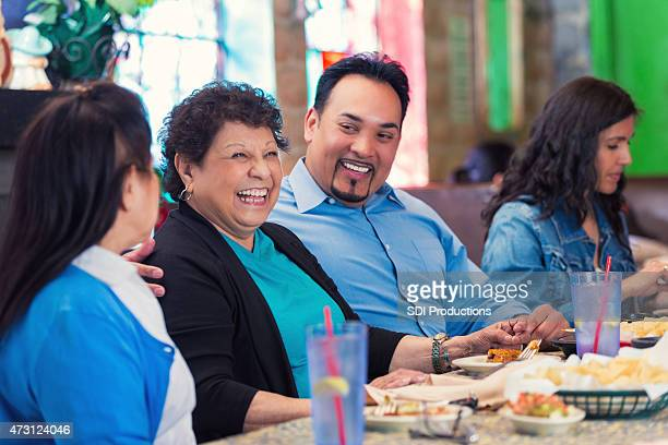 Multi-Generational Hispnic family enjoying meal in restaurant