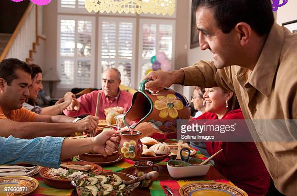 Multigenerational Mexican Family Celebrates dinner