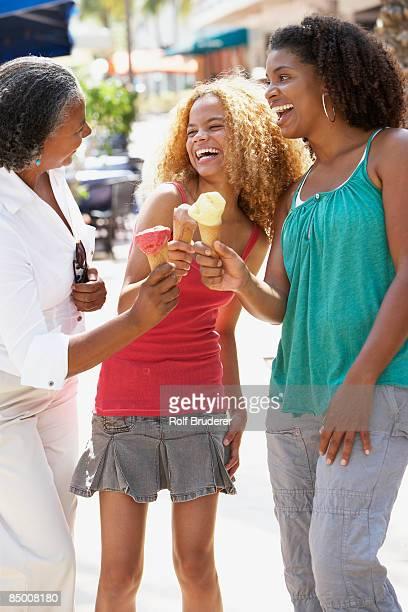 Multi-generational women eating ice cream cones