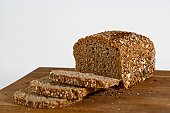 Multi-grain bread on wooden cutting board