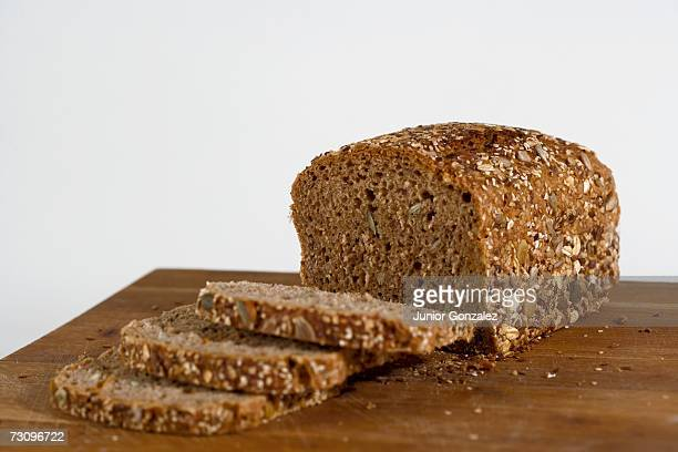 Multi-grain bread on wooden cutting board