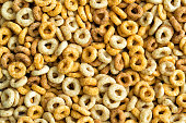 Multigrain cereals in a form of rings different colors, close-up, food background