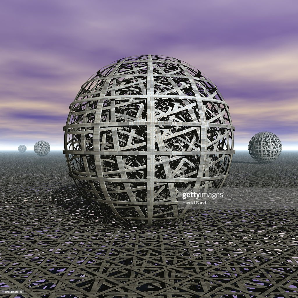Multi-layered metal mesh spheres on a mesh surface : Stock Photo