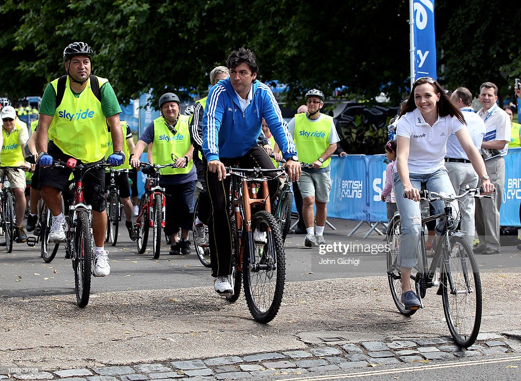Multi-Michelin starred chef Jean-Christophe Novelli (C) and Olympic Gold Medallist Victoria Pendleton (R) join thousands of participants at Sky Ride Southampton, a free, fun. family oriented traffic-free mass participation cycling event held on July 25, 2010 in Southampton, England.