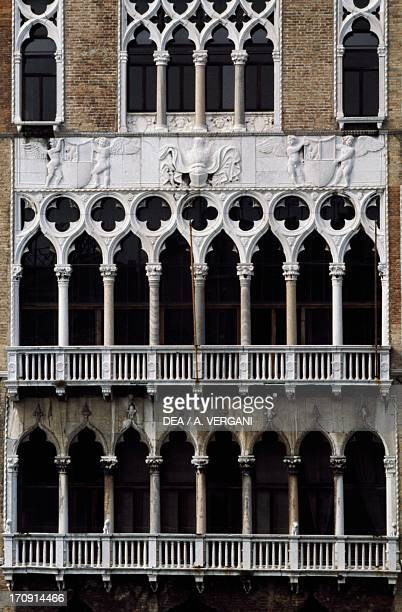 Multimullioned window on the second floor and agglomerated stone frieze Ca' Foscari Venice Veneto Italy