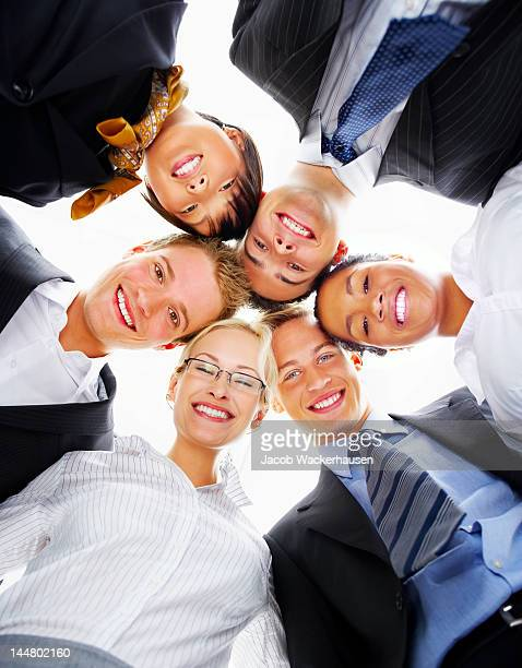 Multinational group of business people with their heads together