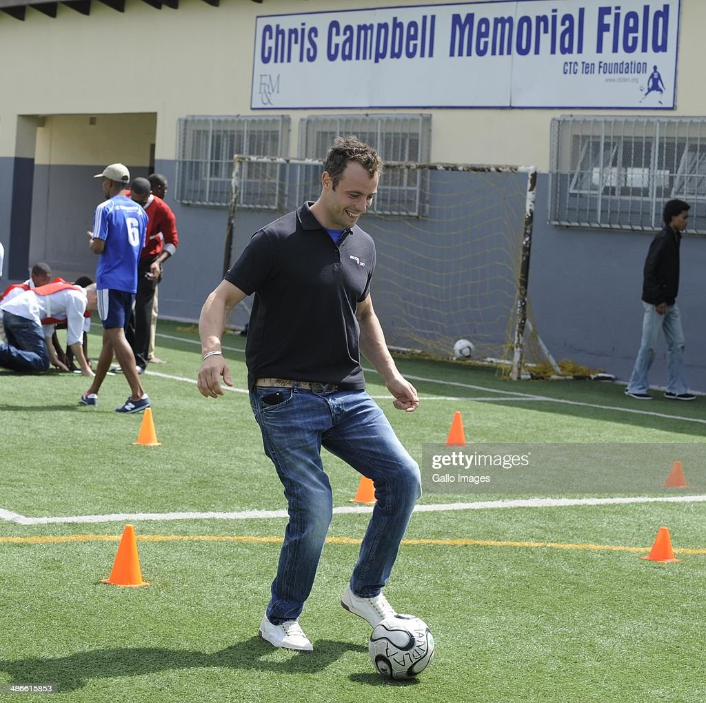 MultiOlympic Gold Medallist Oscar Pistorius with Amandla youth during day 3 of the Beyond Sports event from Crystal Towers on December 07 2011 in...