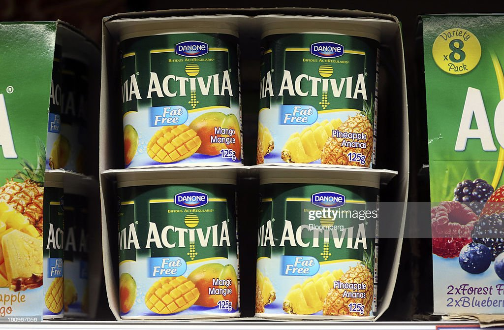 Multi-pack pots of Activia yoghurts, produced by Danone SA, sit on a shelf in the chilled section of a supermarket in London, U.K., on Friday, Feb. 8, 2013. Britain's economy will grow more slowly this year than previously forecast and stagnation may persist, according to the National Institute of Economic and Social Research. Photographer: Chris Ratcliffe/Bloomberg via Getty Images