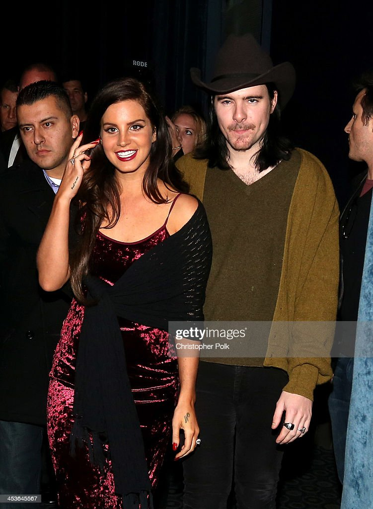 Multi-platinum artist Lana Del Rey (L) and Barrie James O'Neill attend premiere of 'Tropico' at Cinerama Dome at ArcLight Cinemas on December 4, 2013 in Hollywood, California.