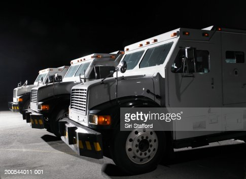 Multiple armored trucks in row