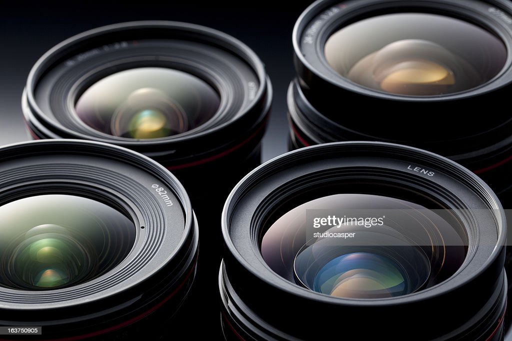 Multiple camera lenses, reflective lenses : Stock Photo