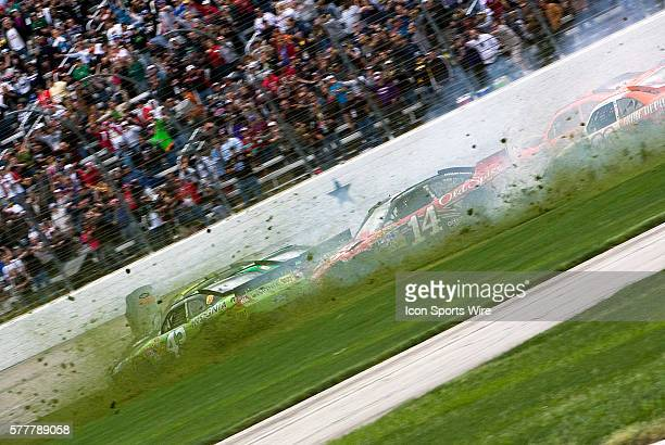A multiple car wreck brings out a red flag at Texas Motor Speedway during the running of the Samsung Mobile 500 race in Fort Worth TX on Apr 19 2010