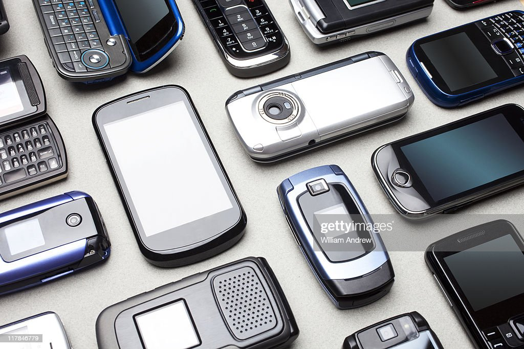 Multiple cell phones on table : Stock Photo