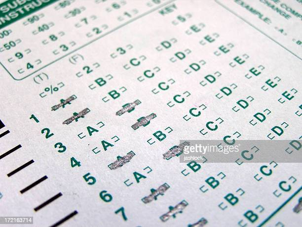 Multiple choice answer sheet close-up, part completed