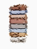 Multiple colored bars of powdered makeup