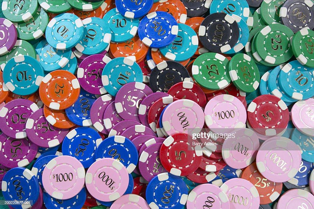 Multiple coloured gambling chips, full frame : Stock Photo